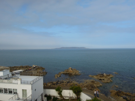 The view from atop the tower looking over the Forty Foot bathing place and onwards to Howth across Dublin Bay.